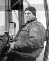 Механизатор В. А. Борзенков осуществляет настройку трактора перед выходом в поле.
