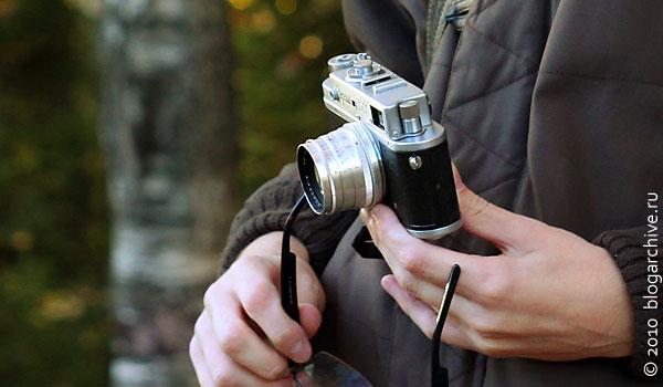 Фотограф с фотоаппаратом ФЭД.